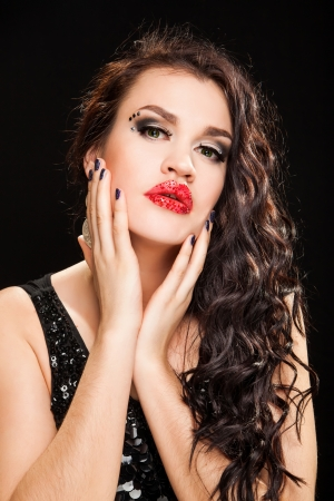 Fashionable Brunette creative Makeup Woman with healthy dark curly Hair photo