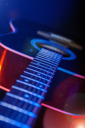 acoustic Guitar on a bright background closeup