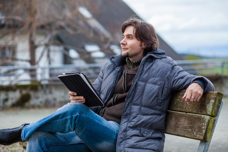 Man with tablet outdoor