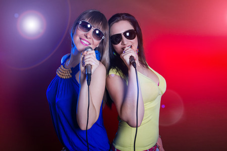 female singer: young beautiful girls dancing and singing