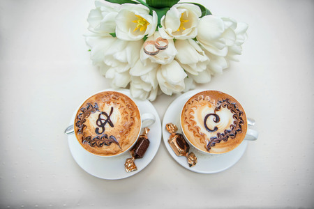 Wedding two cups of cappuccino with letters