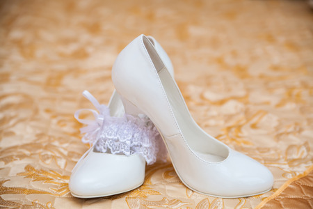 beautiful white shoes and brides accessories