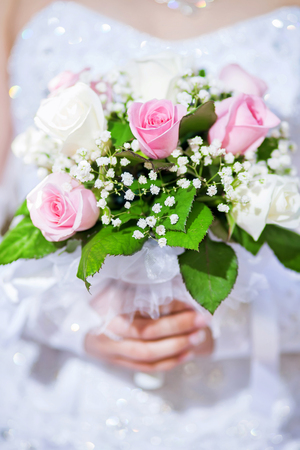 beautiful tender bridal bouquet of roses holding bride