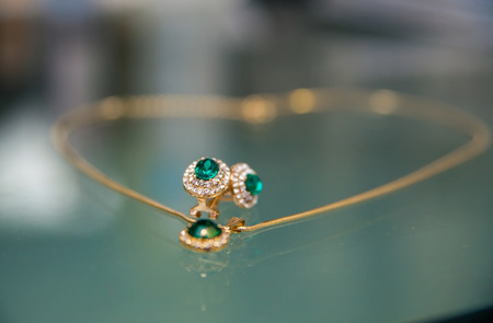 Brides Necklace with green stone on the table