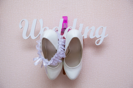 beautiful white shoes and accessories for bride