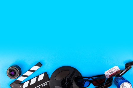 Cinema Film Background Camera With Clapperboard, Tickets, Rolls, Glasses popcorn, lens, reel, film and soda Stock Photo