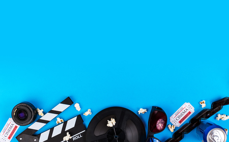 Cinema Film Background Camera With Clapperboard, Tickets, Rolls, Glasses popcorn, lens, reel, film and soda Imagens