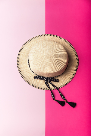 girl fashion hat on pink paper, minimal style background Stock Photo
