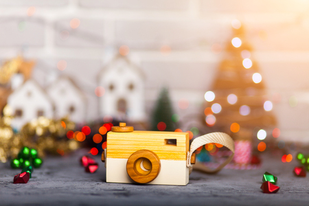 Wooden camera with defocused bokeh background. Copyspace with room for your text.