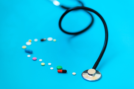 Medicine stethoscope and different capsules and pills Stock Photo