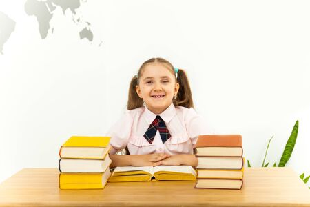 education and school concept - smiling little student girl with many books at school Stock fotó