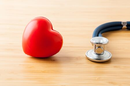 Stethoscope and red heart on wooden table. Cardiology concept Фото со стока - 131389732