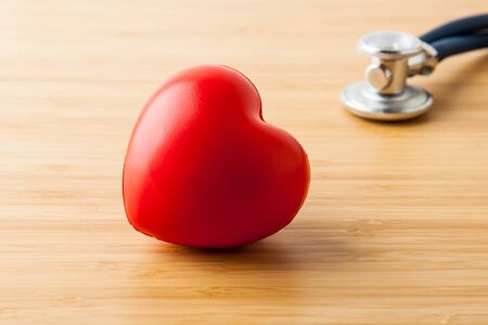 Stethoscope and red heart on wooden table. Cardiology concept Фото со стока - 131389352