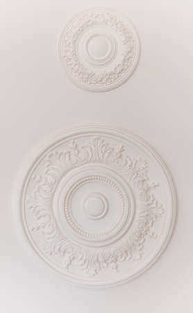 round floral stucco moulding rosette on white ceiling