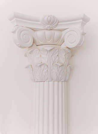 Decorative detail of an ancient white Ionic column. close up.