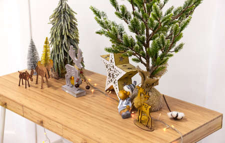 Christmas decorations, wooden deers, trees on table. Christmas holiday celebration concept
