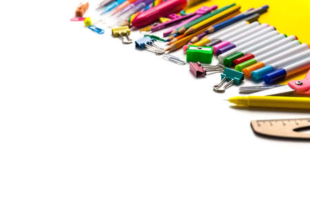 Back to school. Lots of different school supplies stacked on one side, lots copy white space for text Stock Photo
