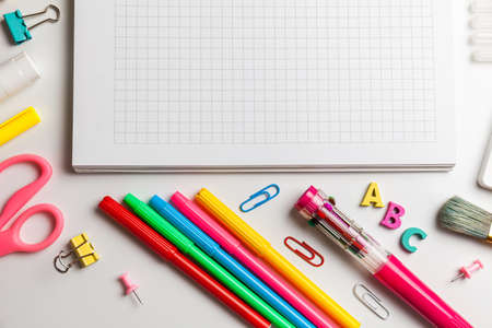School office supplies on a desk with copy space. Back to school concept. Archivio Fotografico