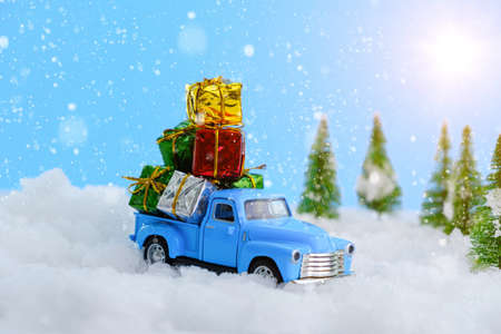 Merry Christmas tree transporter bringing gifts to all the sweethearts on xmas evening Stock Photo