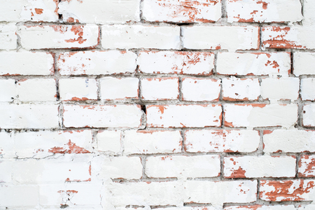 Vintage background: old red and white brick wall.Old white brick wall with textured background. Whitewashed grunge brick wall with red and white vintage background. Stock Photo