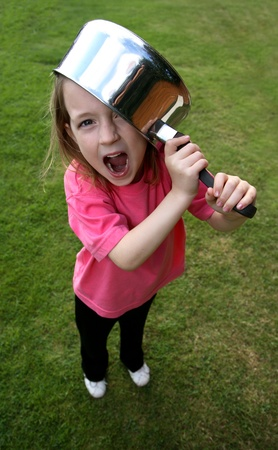 Young girl with a saucepan on her head Stock Photo - 9011119