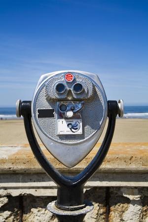 Sightseeing binoculars on a beach front