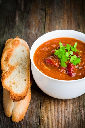 A bowl of chili con carne with toasted baguette and coriander Stock Photo