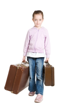 Young girl about to run away from home with her suitcase Stock Photo - 9088390