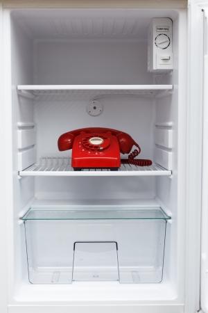 Hidden vintage British red phone in a fridge