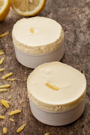 creamy lemon souffle on a wooden background