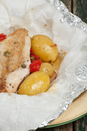 Chicken and potatoes cooked in a bag Stock Photo