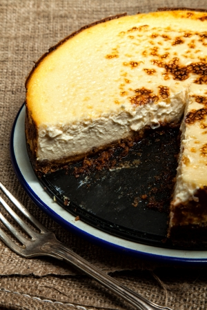 Homemade New York cheesecake with a slice missing