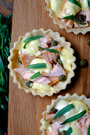 Salmon and hollandaise mini tarts with capers and tarragon  Stock Photo