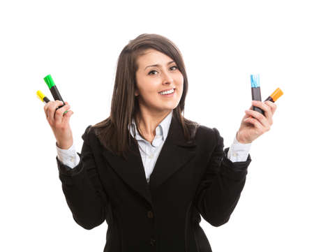Young beautiful woman holding colorful highlighters photo