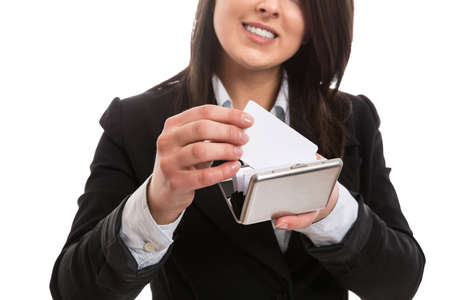 Young businesswoman putting business card in holder photo
