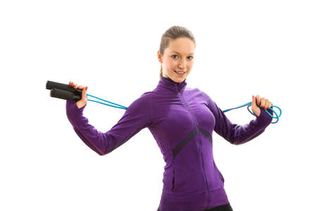 cardiovascular exercising: Beautiful young woman with jump rope Stock Photo
