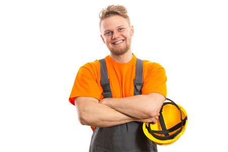 construction site helmet: Smiling construction worker Stock Photo