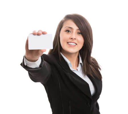 Young attractive businesswoman showing blank business card photo