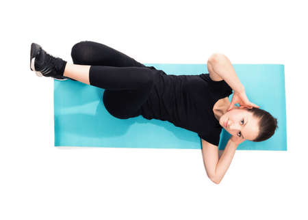 crunches: Fit woman doing crunches on exercise mat