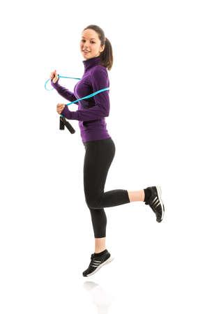 saltar la cuerda: Colocar la mujer con cuerda de saltar