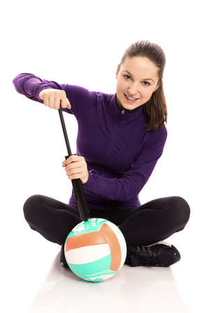 volley ball: Woman pumping volley ball