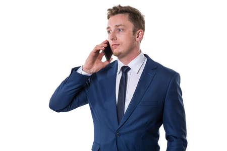 discontented: Confused businessman talking on cellphone