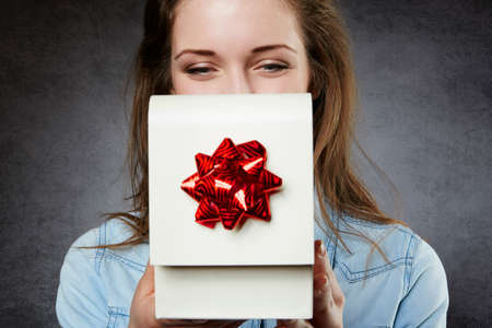 opening up: Close up of woman opening present Stock Photo