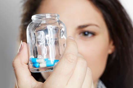 holding close: Close up of woman holding pill container Stock Photo