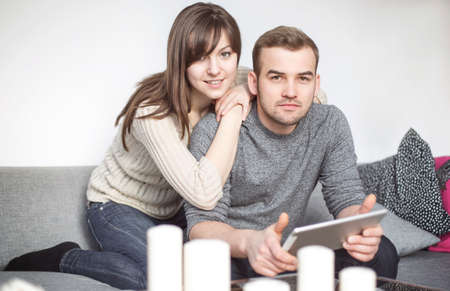 surfing the net: Couple sitting on a sofa and surfing the net