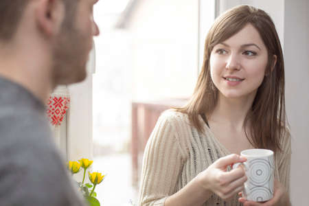 flirting women: Attractive wife talking with her husband