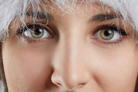 zoomed: A photo of face of young woman, zoomed on her eyes.