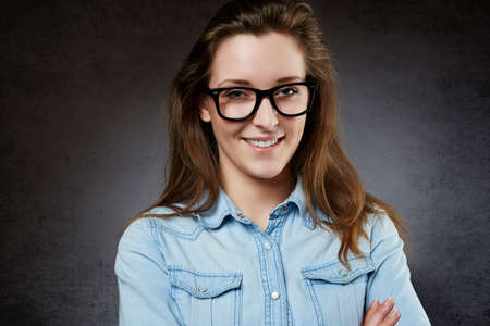 nerdy: Smiling cute teenager in nerdy glasses Stock Photo