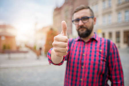 city people: Blurred man showing ok gesture Stock Photo