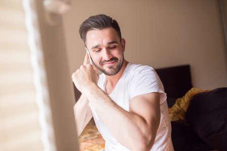 latino man: Handsome latino man showing bicep